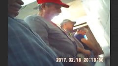 Men pissing in trough urinal