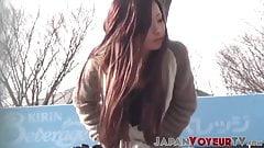 Japanese hottie filmed pleasuring herself on public bench