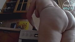 curvy mistress in the kitchen twists a big ass
