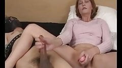 Hot cougar strokes a big cock and fucks herself with a dildo