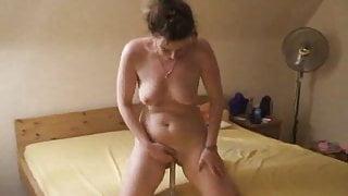 upright masturbating on bed