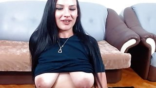 Greek girl lets her big saggy tits hang down her shirt