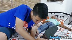 Asian twinkie sucks little toes before riding big dick