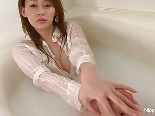 Wet and messy orgy tube Sexy japanese babe gets wet and messy in the bathtub