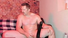 Beefy guy fuck himself with dildo