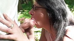 mature slut gives outdoor blowjob with cum in mouth