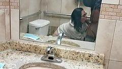 Public bathroom blowjob