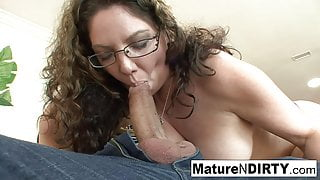 Brunette MILF in glasses seduces her nephew on the couch