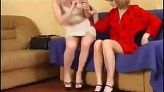 Two Lesbians Sit On The Couch And Play With Themselves