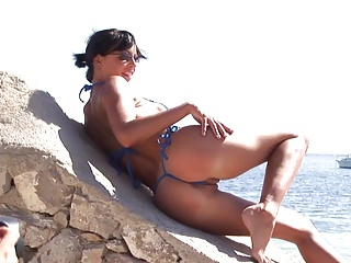 Free photos women in micro bikinis - Hot brunette milf in micro bikini posing on public beach 2