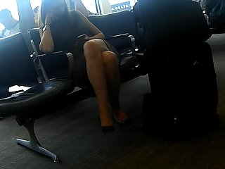 Cross dresser sexy Candid sexy crossed legs and feet in heels at airport