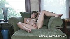 Bushy girl Beryl masturbates on the sofa