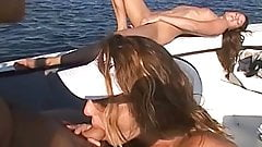 Sexy blonde fucks her husband and girlfriend on a boat