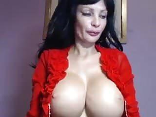 Busty brunette teasing - Busty milf teases oils up on cam