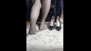 schoolgirl shows her sexy legs in heels