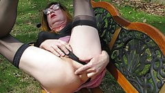 Sexy shemale squirting on a park bench