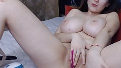 Big tit slut plays with her pussy