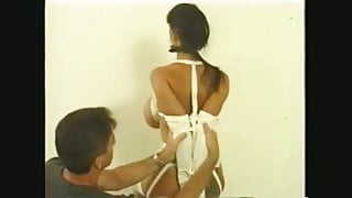Chairtied Brunette Has Her Mega Boobs Tied