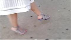 Blonde feet in high wedges walking