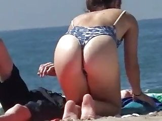 Cute asses in bikinis Cute whore with a nice ass shows it off on the beach