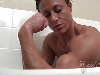 Female playing with dildo - Ripped naked female bodybuilder plays in the bathtub