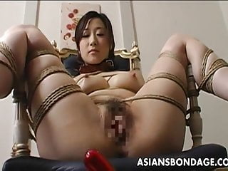 Waxed asian Toy fucked tied up and pussy waxed
