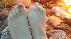 Cum on toes by the campfire