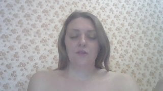 Girl with big tits and hairy pussy plays and pisses