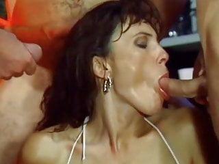 Gang facial video - Brunette gets a gang facial