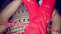 Miss Emma relaxing Her red latex boots on slave