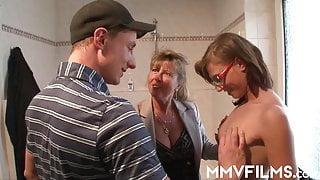 German swinger Petra Wegat in a bathroom threesome