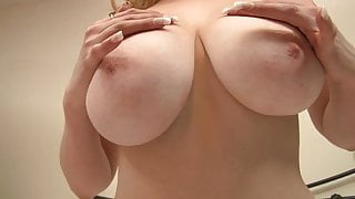 Cute blonde gets playful with a her huge bazookas
