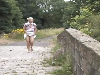 Pissing in a river - Girl empties her full bladder into the river pee