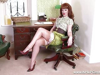 Bare pussy masturbation Redhead babe strip teases showing nyloned legs bare pussy