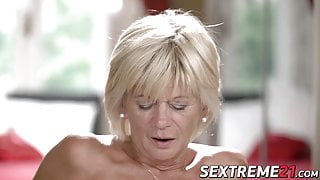 Horny granny enjoys riding and sucking big young dick