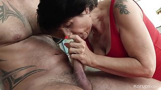 Sexy brunette granny fucks young man in the gym