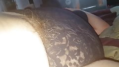 long soft pubes hanging from her black girdle,