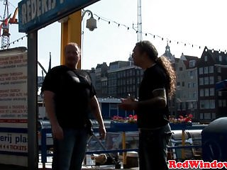 Amsterdam gay prostitution - Amsterdam prostitute handling cum in mouth