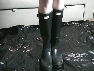 Lycra fetish shiny Rubber apron and black shiny rubber boots with puppy play