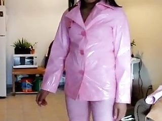 Pvc latex leather clothing Asian in light pink pvc jacket and pink leather pants