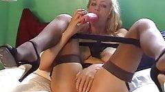 British slut Starr fucks herself on the bed