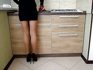 Pantyhose pics with mini skirts - Heels, tights and mini skirt cooking to eat in the kitchen