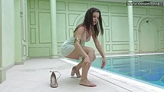 Sexiest petite teen Lizi Vogue swims naked in the pool