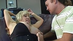 Busty blond MILF gets her titties sucked by young stud