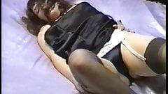 Brunette masturbating in black satin dress and panties