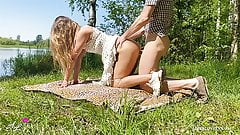 Teen amateur couple has outdoor sex by a lake in the summer