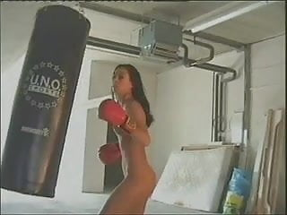 Saddle bag thighs milf Hot brunette is punching bag nude and then masturbates