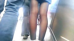 Upskirt on escalator 3 - beside her boyfriend