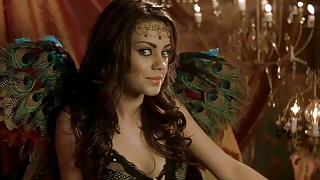 Mila Kunis shows cleavage