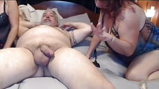2 busty babes tie daddy up and take turns sucking his dick